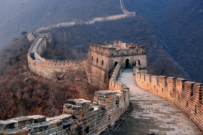 Great Wall sunset over mountains in Beijing, China_shutterstock_142871650