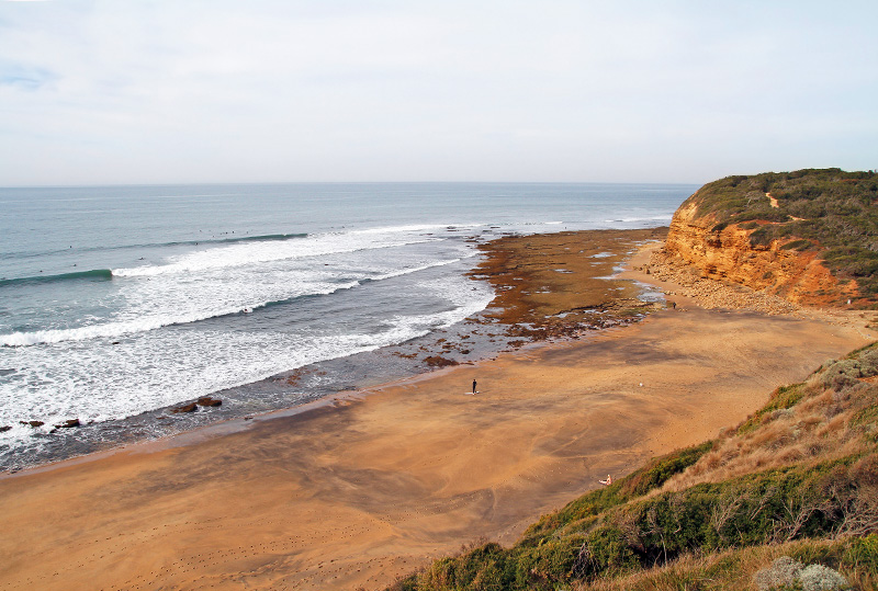 Surfers on Bells Beach, Victoria, Australia