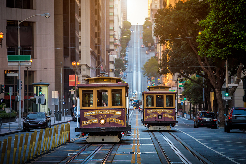 San Francisco cable cars ascend hill
