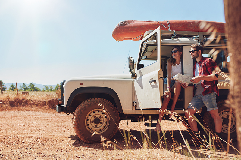 Couple with Jeep ready for a Road trip through the desert