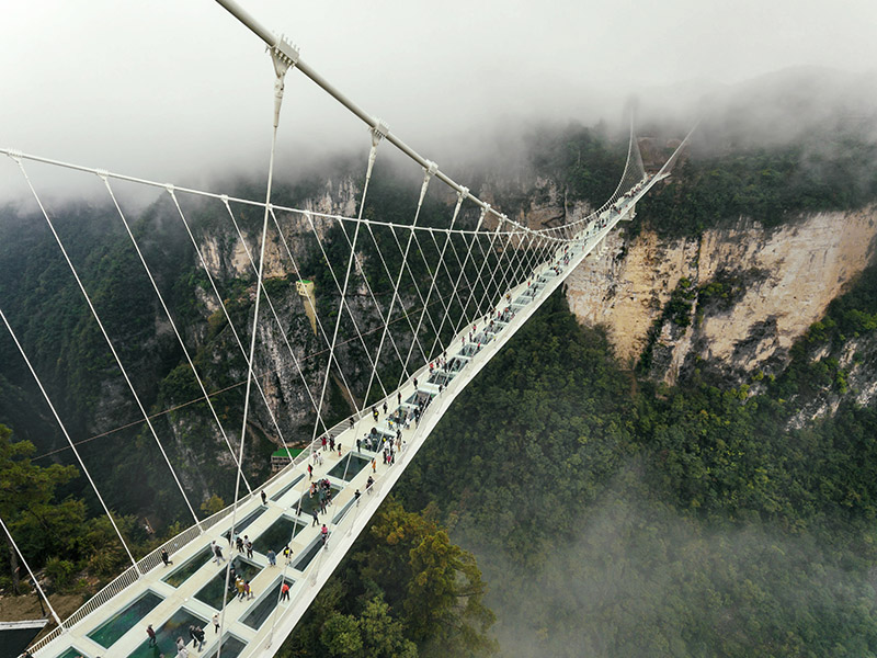 Aerial view of glass bridge at eco-travel destination Zhangjiajie, Hunan - the world's highest and longest glass Bridge.