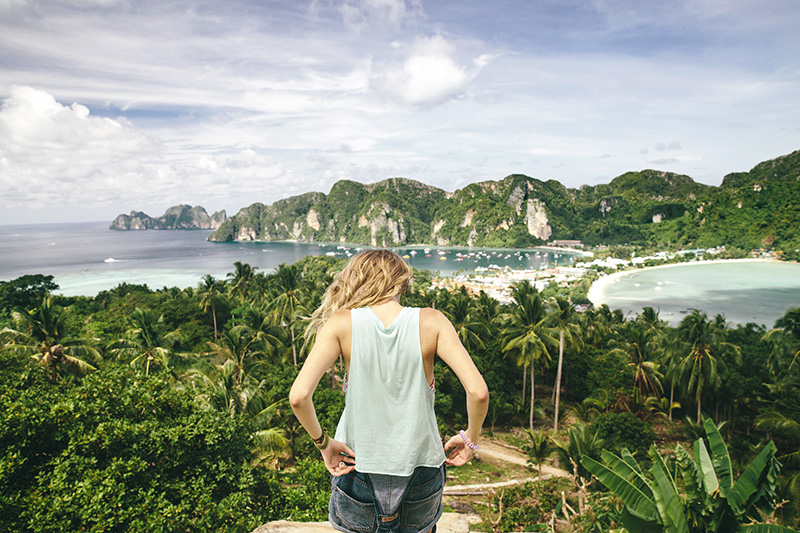 Back view of female eco-tourist against of beautiful scene of Phi-Phi island panorama in Krabi, Thailand