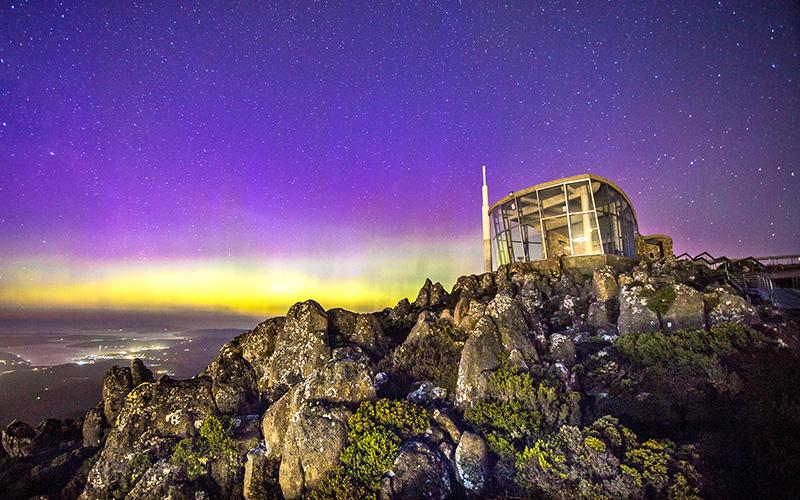 Aurora Australis - purple sky as seen from eco-travel trip to Tasmania