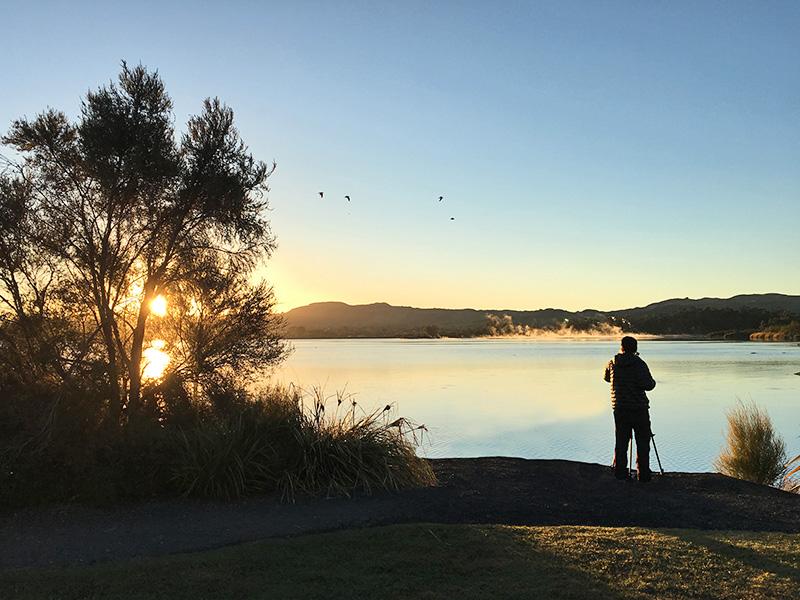 Eco-tourism at Lake Rotorua at sunrise - North island of New Zealand