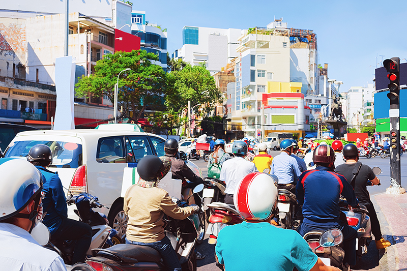 People on Scooters and motorcycles in the street of Ho Chi Minh City, Vietnam