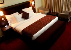 Best Western PLUS Elomaz Hotel - Asaba - Bedroom