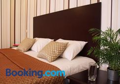 Hotel Business Apartments - Dnepropetrovsk - Bedroom