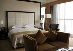 Ramada Plaza Weifang - Weifang - Bedroom