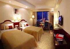 Ramada Plaza Tian Lu Hotel Wuhan - Wuhan - Bedroom