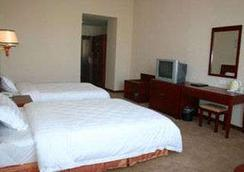 Super 8 Hotel Nanchang Wan Da Xing Cheng - Nanchang - Bedroom