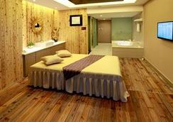New Beacon Luguang International Hotel - Wuhan - Bedroom
