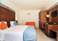 Bénin Royal Hôtel - Cotonou - Bedroom