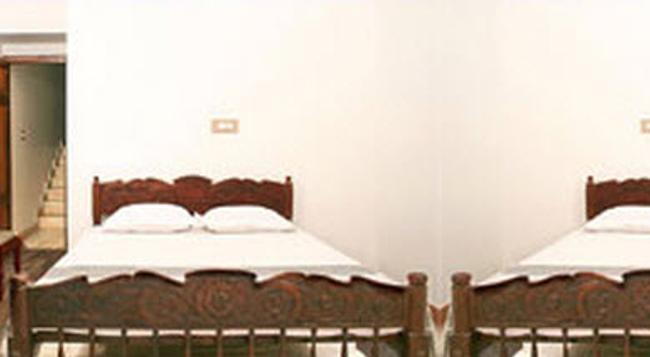 Vasco da gama Inn - Kochi - Bedroom