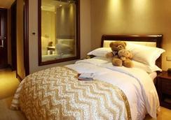 Henan Hairong Hotel - Zhengzhou - Bedroom