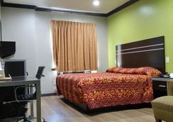Woodland Inn - Humble - Bedroom
