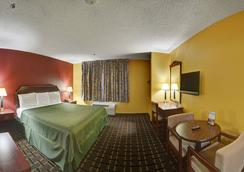 Americas Best Value Inn & Suites - Longview - Bedroom