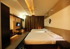 Fabhotel Arafa Inn Gandhinagar - Bangalore - Bedroom