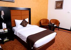Royal Grand Suite Hotel - Sharjah - Bedroom