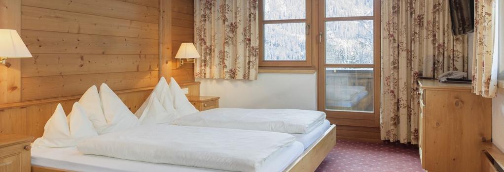 Hotel Grischuna - Sankt Anton am Arlberg - Bedroom