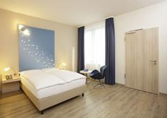 H2 Hotel Berlin Alexanderplatz - Berlin - Bedroom