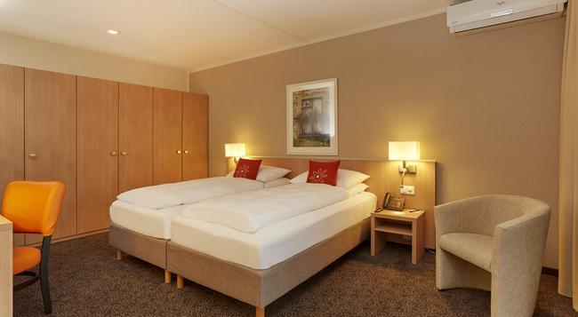 H4 Hotel Arcadia Locarno - Locarno - Bedroom