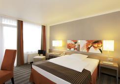 H4 Hotel Frankfurt Messe - Frankfurt am Main - Bedroom