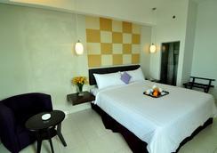 Aston Ketapang City Hotel - Ketapang - Bedroom
