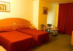 Ascot Lodging - Cardano al Campo - Bedroom