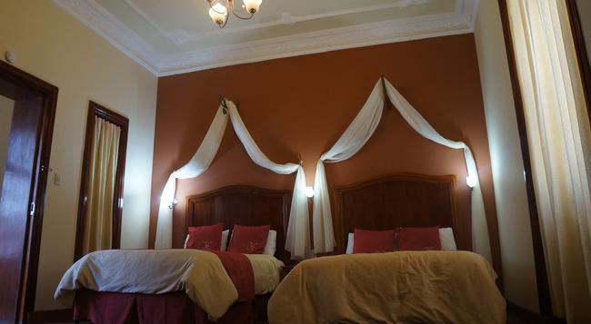 Hotel Boutique La Circasiana - Quito - Bedroom
