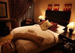 African Footprints Lodge - Bloemfontein - Bedroom