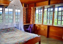 Labang Longhouse Lodge - Bario - Bedroom