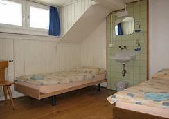Happy Inn Lodge - Interlaken - Bedroom