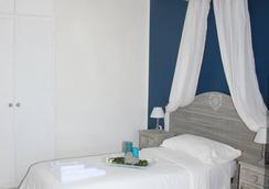 Metropolis Rooms & Services - Fiumicino - Bedroom