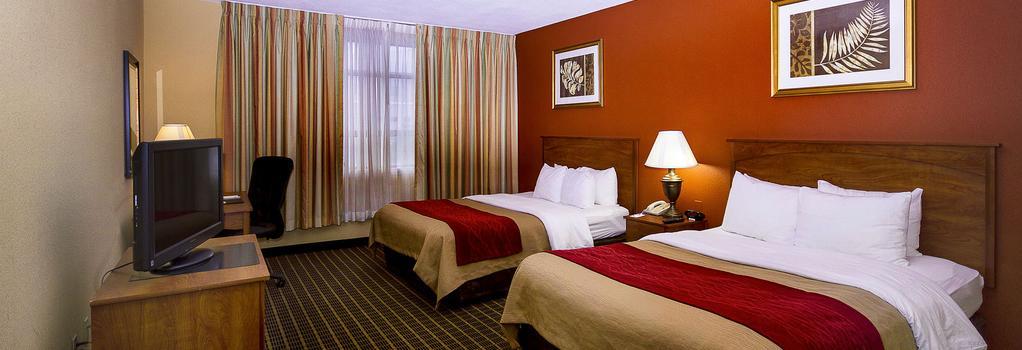 Clarion Inn & Suites Miami Airport - Miami Springs - Bedroom