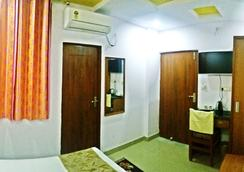 Airport Sky Inn - Jaipur - Bedroom