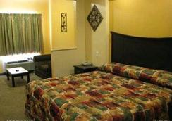Homegate Inn And Suites - West Memphis - Bedroom