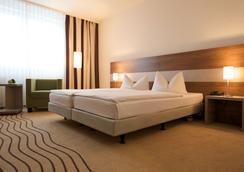 City Hotel Berlin East - Berlin - Bedroom