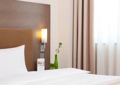 Intercityhotel Leipzig - Leipzig - Bedroom