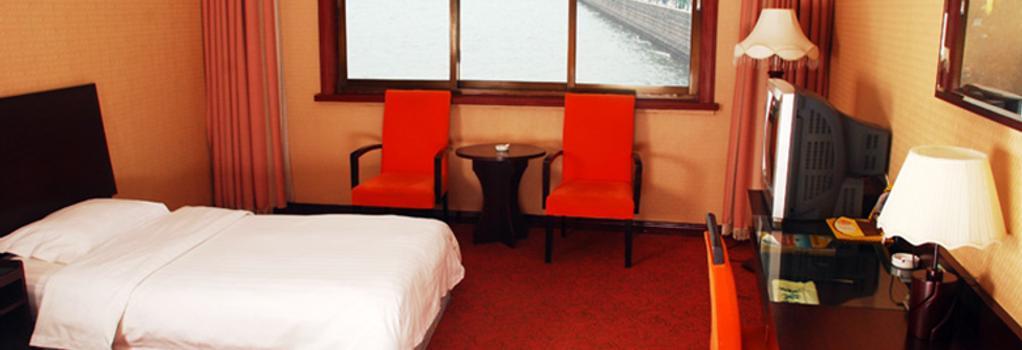 Qingdao Huaneng Hotel - Qingdao - Bedroom