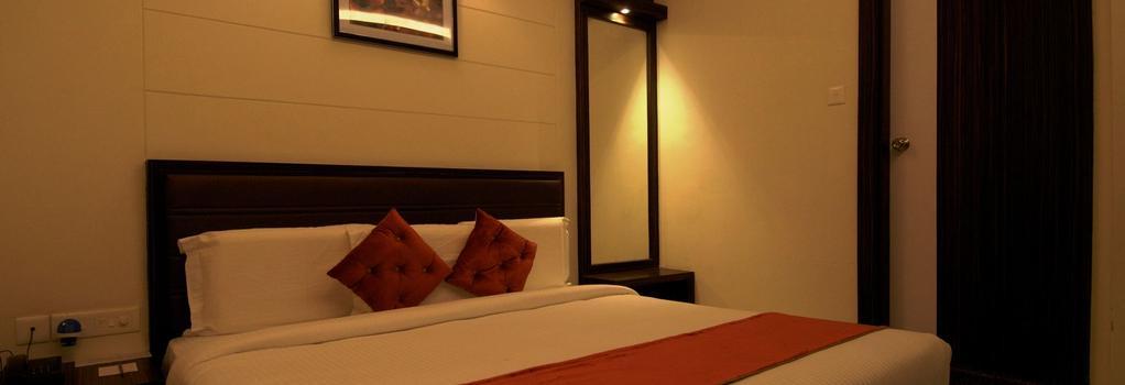Hotel Premiere Villa - Varanasi - Bedroom